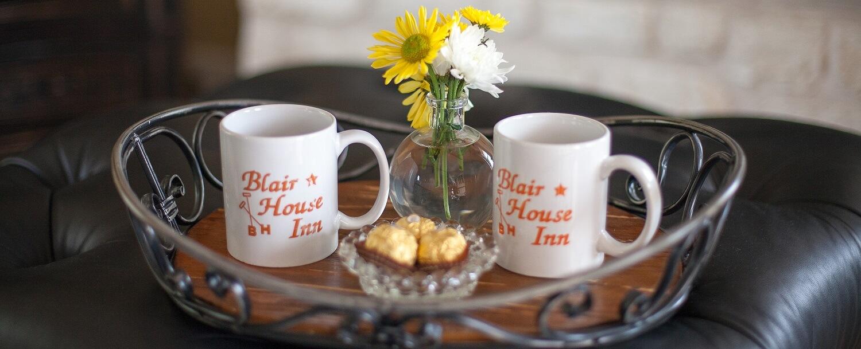 Blair House Inn coffee mugs on tray