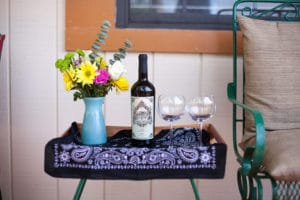 Patio table with flower and wine
