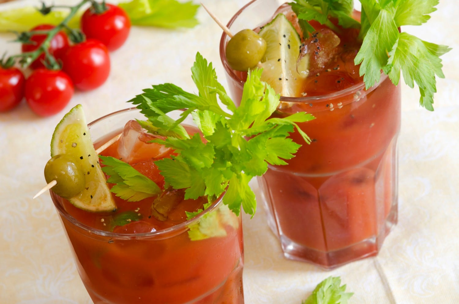 two bloody marys with garnish